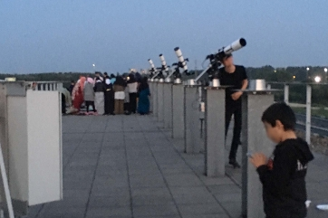A group of people on the roof at the Anton Pannekoek Institute during one of the Altair events.