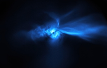 A blue irregular nebula (resembling a bird) around a star-forming disk